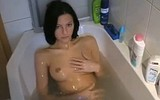 Naked girl takes bath and gives her BF a blowjob