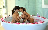 Naked girls taking bath together