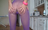 Young girl with amazing legs plays in the kitchen on her webcam