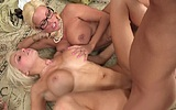 Naked girls with big tits satisfying one cock