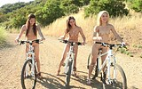 Naked girls on bicycles