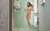 Naked babe with big tits taking a shower